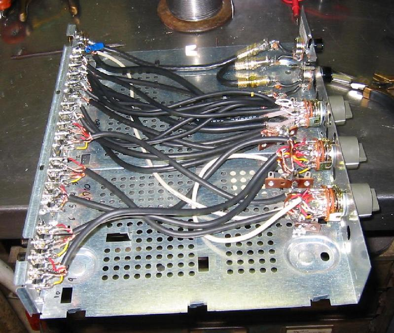 this picture shows the two audio selector switches connected to the rear  jacks  the wire is from a 5 pin din audio cable and makes the wiring easier  than
